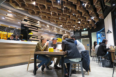 First floor of Ice Monster Omotesando, Tokyo, with woodwork ceiling.