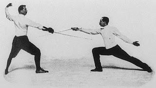 Italo Santelli, left, in action at the Paris Olympics of 1900, in which he won a silver medal in the sabre event
