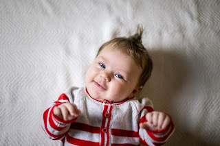Infant smiling at camera during Christmas Mini Ideas for San Diego California Photographers by Morning Old Fine Art