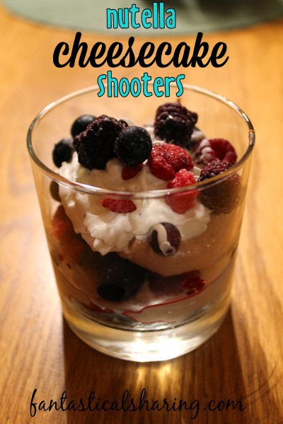 Nutella Cheesecake Shooters   The perfect light dessert with a fluffy cheesecake filling layered with berries and whipped cream on top of a graham crust #SundaySupper #nutella #recipe