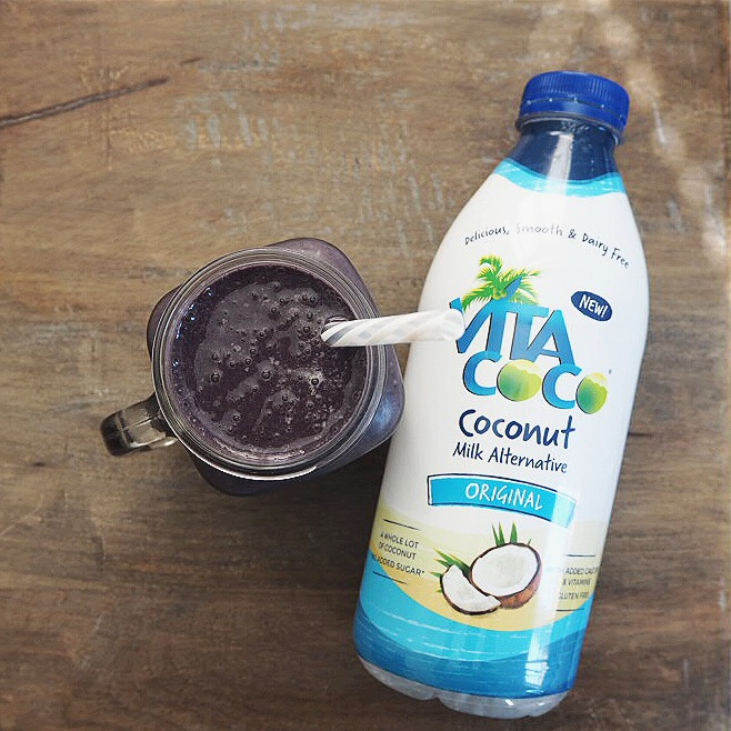 Vegan Coconut Blueberry Summer Smoothie in a mason jar next to a bottle of vita coco coconut milk alternative