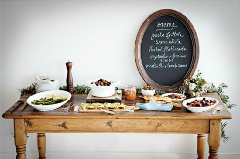 cottage style wood dining table with food display