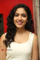 Actress Ritu Varma Stills in White Floral Short Dress at Kesava Movie Success Meet .COM 0141.JPG