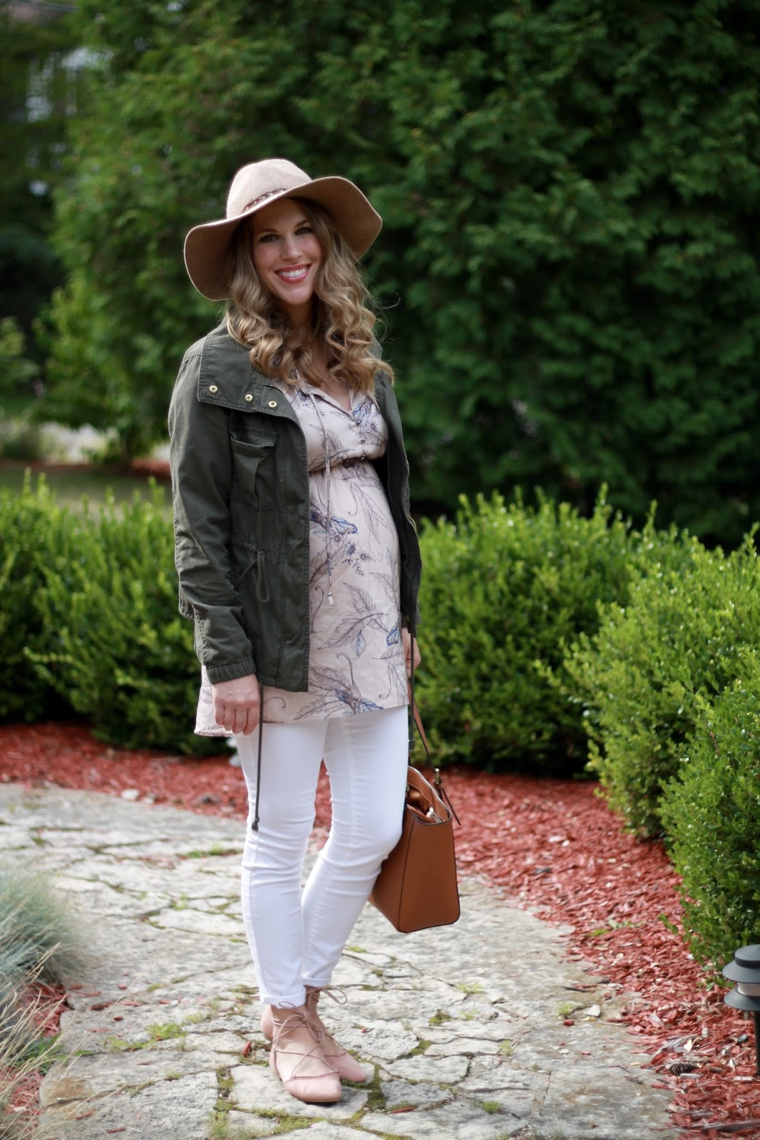 blush floral top, white jeans, cargo jacket, blush lace up flats, tory burch tote, wide brim hat, fall maternity outfit