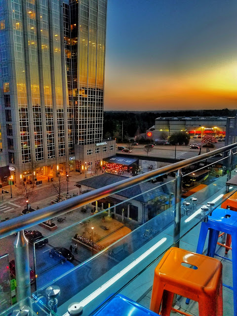 The Level 7RoofTop Bar in the AC Hotel is a cozy-indoor -outdoor space serving up tapas and craft cocktails in the heart of Raleigh, NC.