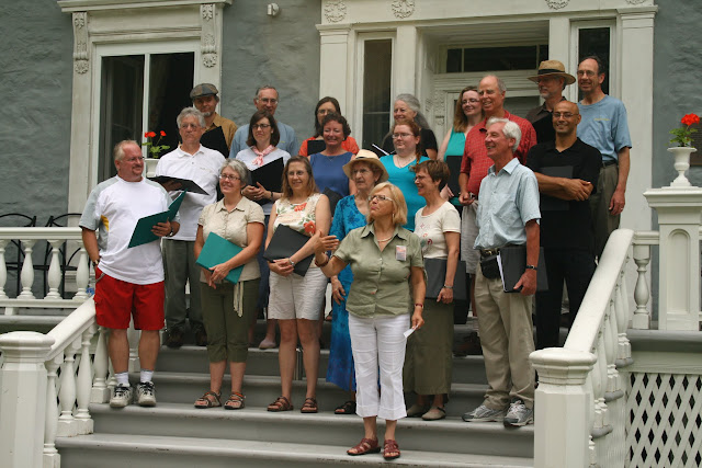 Singing on the steps of the Manoir Papineau behind the Chateau Montebello