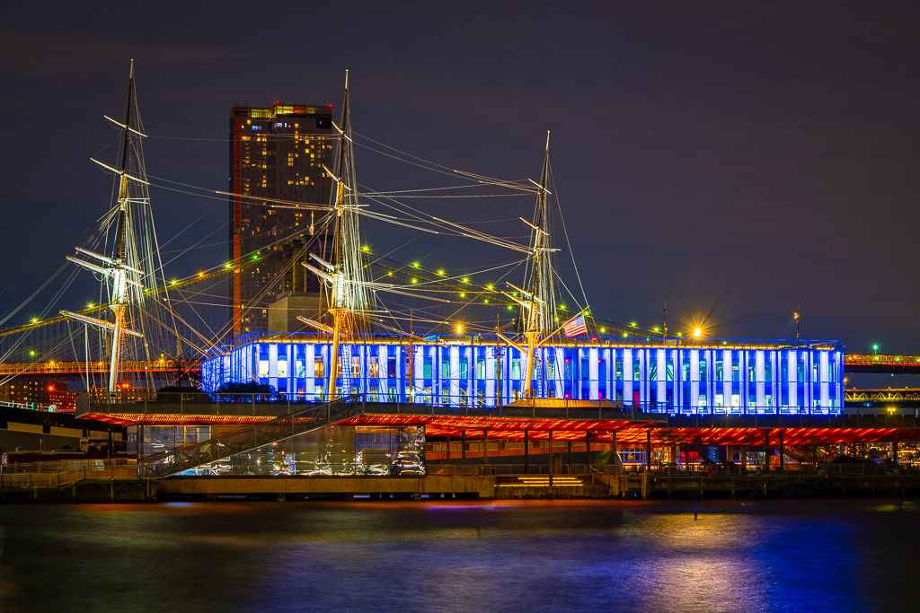 a photo of the new south street seaport pier 17 at night in new york city