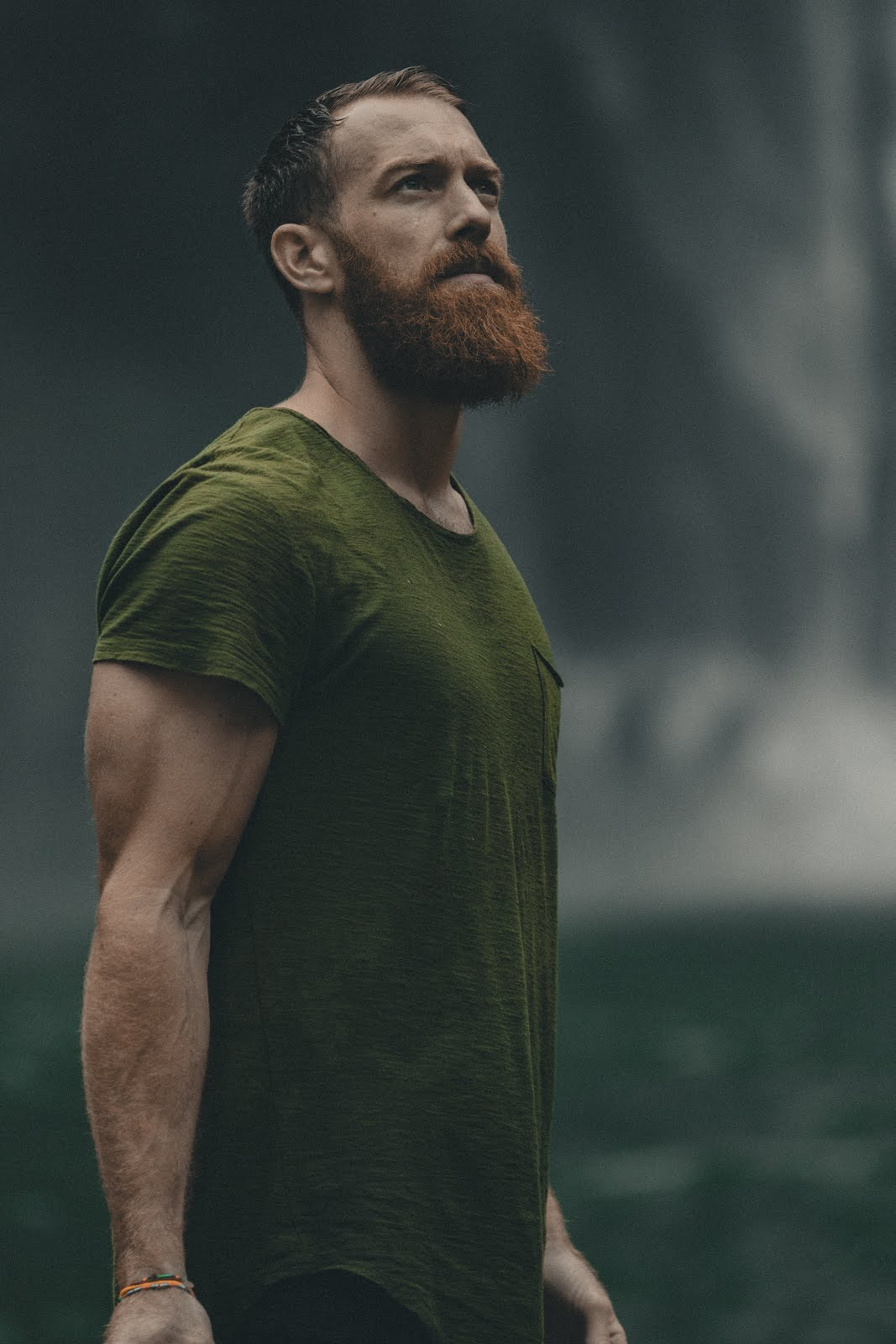 bearded man wearing green shirt