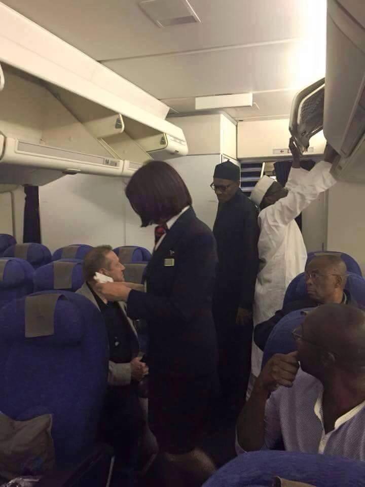 buhari flies economy