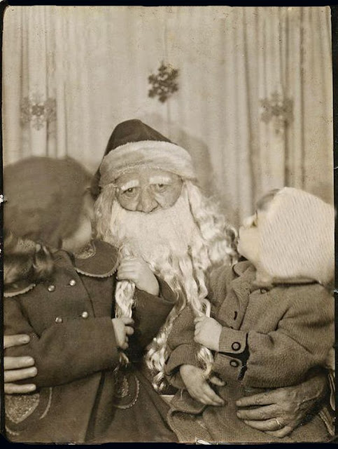 A very tired Santa listens to two girls while they pull on his beard. c.1940s.A Pleasant Christmas Story and other stories of Christmas Creepers. marchmatron.com.jpg
