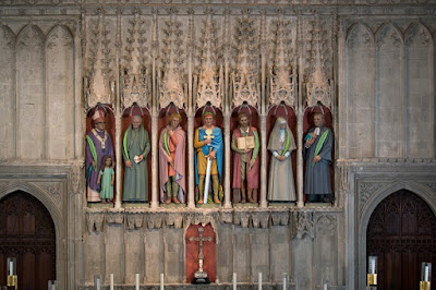 Seven statues of martyrs, sculpted by Rory Young and installed in the niches of the medieval nave screen, St Albans Cathedral