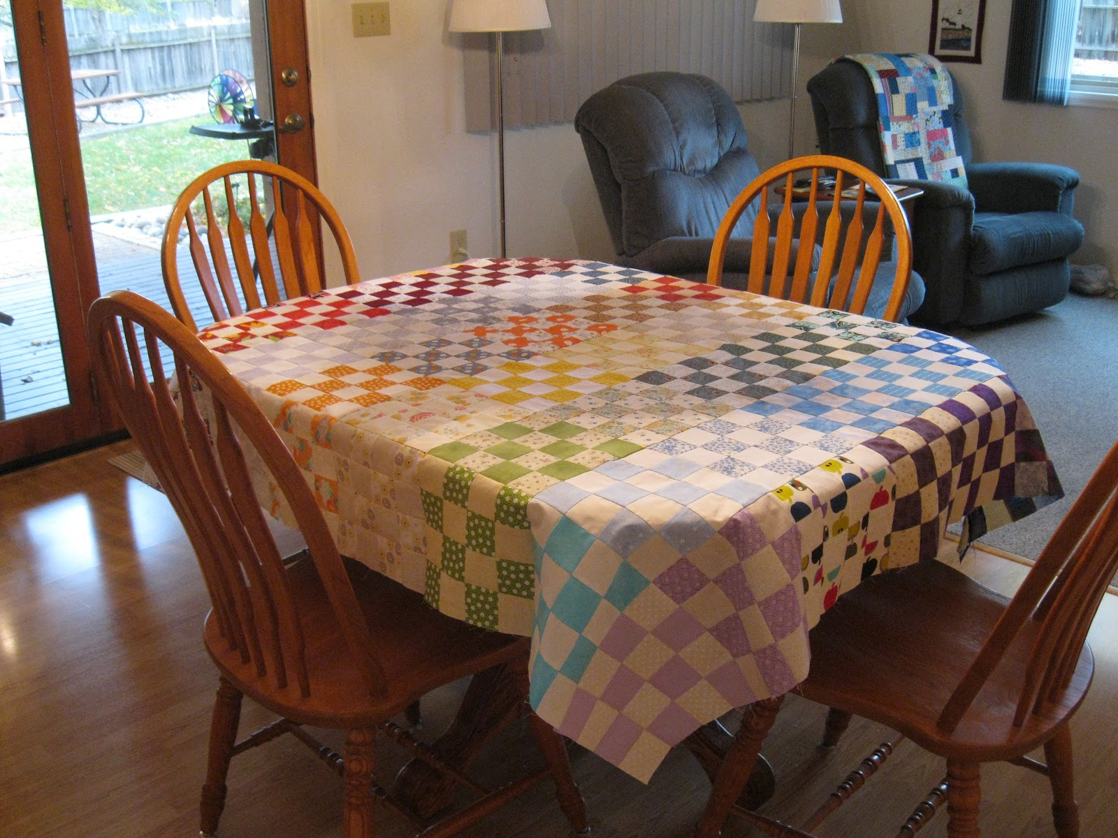 Little penguin quilts one rainbow flimsy for Dining room quilter