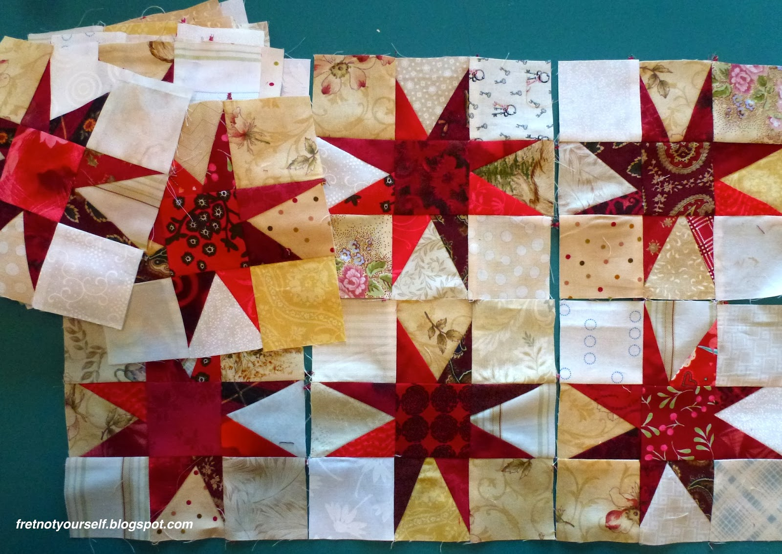 Quilt blocks where the red star points have various lengths.