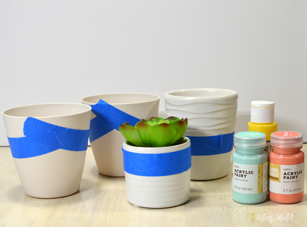 add some painter tape or washi tape to create a color block pattern on succulent pots