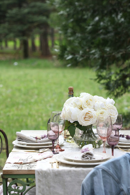 vintage table with pastel stemware and flowers