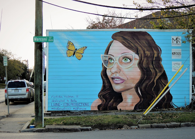 W. Gray at Marconi Street - Mural of girl with glasses and butterfly