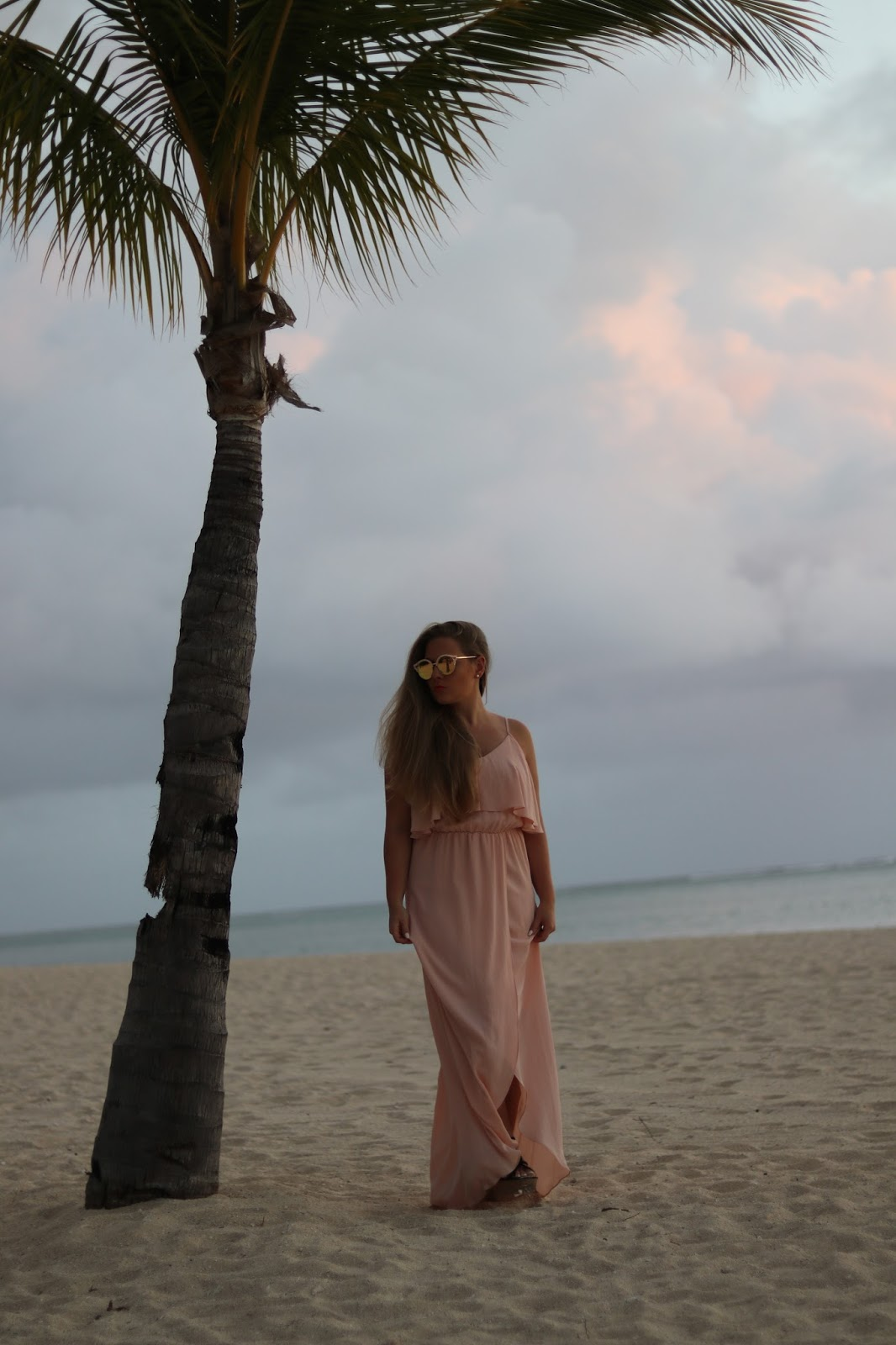Palm tree and girl in pink dress
