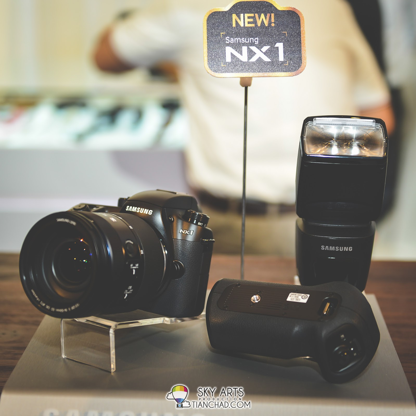 Samsung NX1 with Speed light and battery grip at side