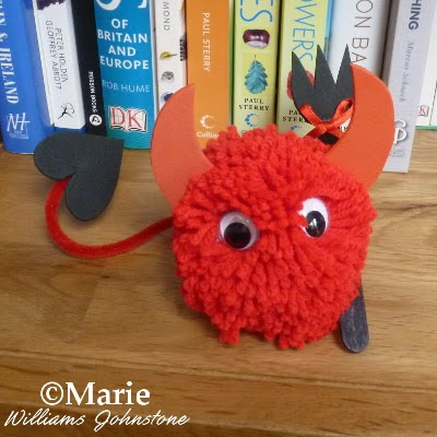 Completed pom pom pet made to look like a little devil character