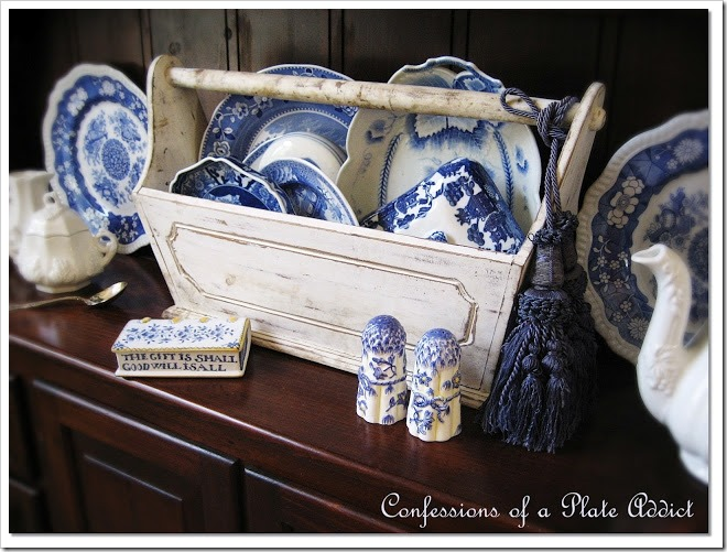 pretty blue and white dishes in a tool caddy