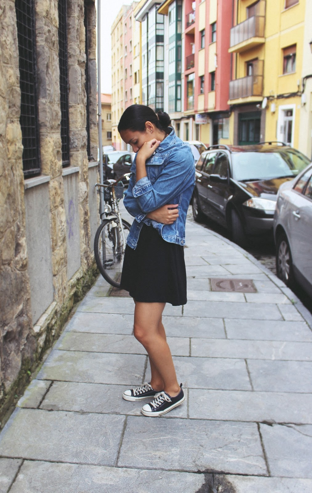denim jacket with black skater dress