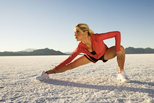 girl-stretching-in-ice-ground