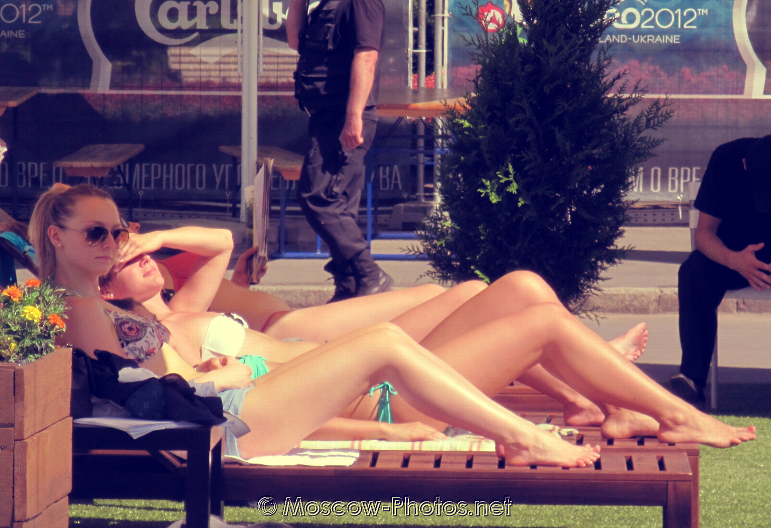 Russian girls sunbathing in the park