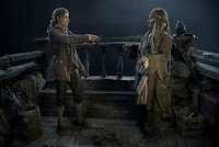 Brenton Thwaites and Johnny Depp in Pirates of the Caribbean: Dead Men Tell No Tales (2)
