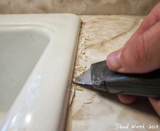 how to remove cracked caulk, sink, razor blade, utility knife