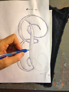 tracing the letter onto fabric
