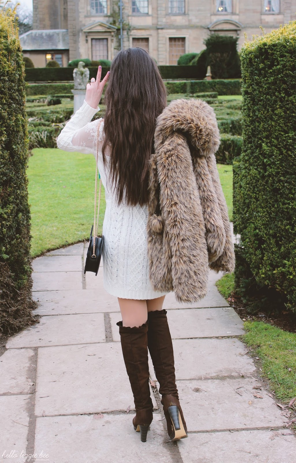 full outfit shot, white sweater dress and leopard print coat