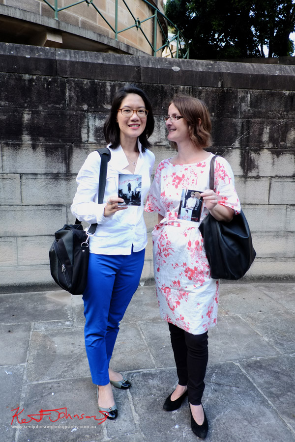 Double portrait, friends, blue slacks white blouse; black pants worn under cotton floral print dress.
