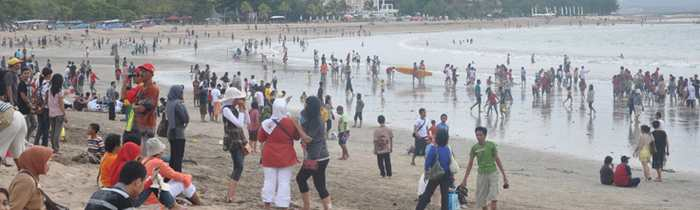 Kuta beach area is increasingly crowded and increasingly jammed roads
