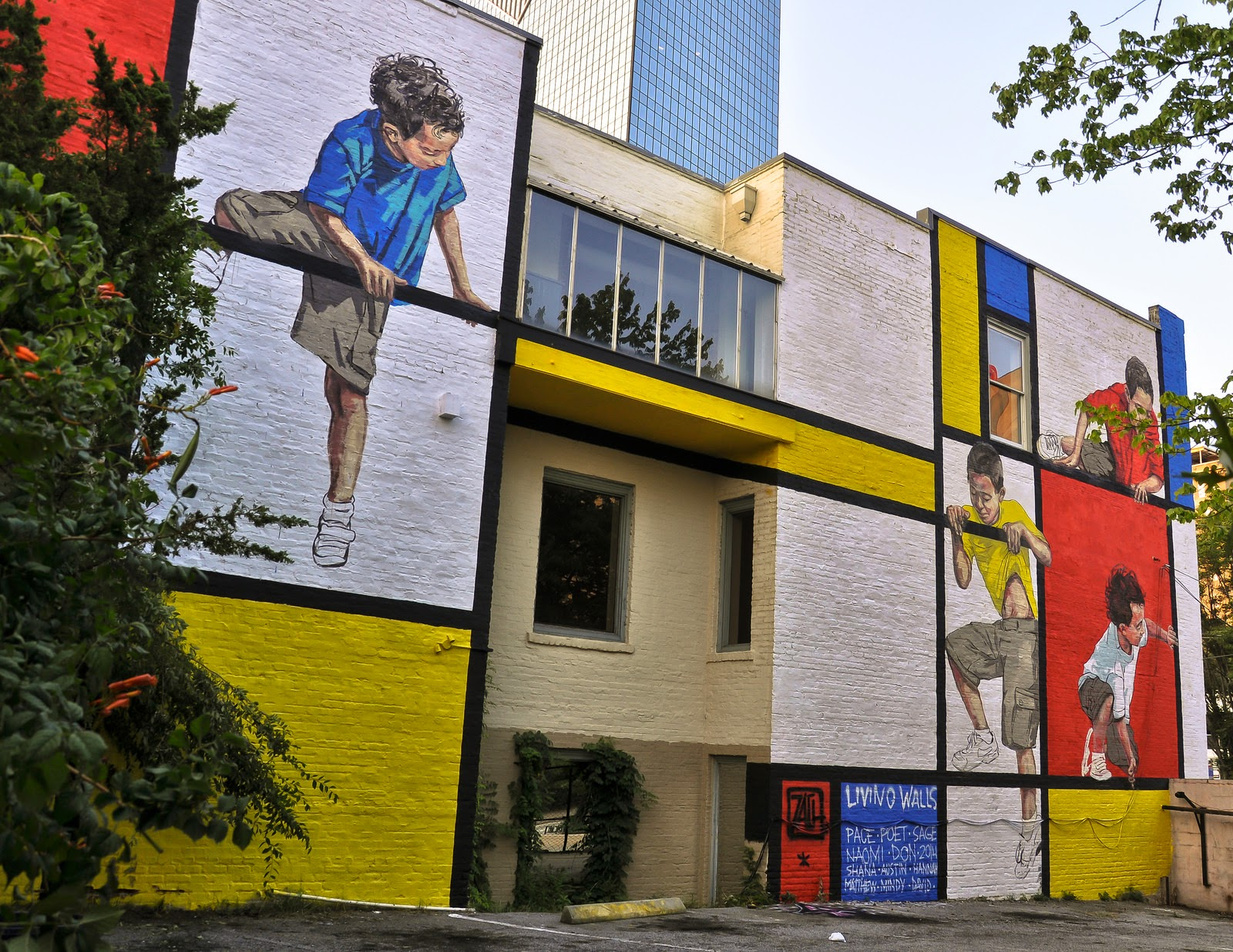 Ernest Zacharevic was also invited in the Living Walls 2014 conference where he worked his magic on this massive new piece.