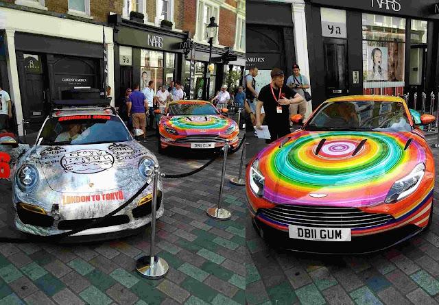 Porsche und Aston Martin DB2 in Regenbogenfarben auf dem Gumball3000 Launch 2018