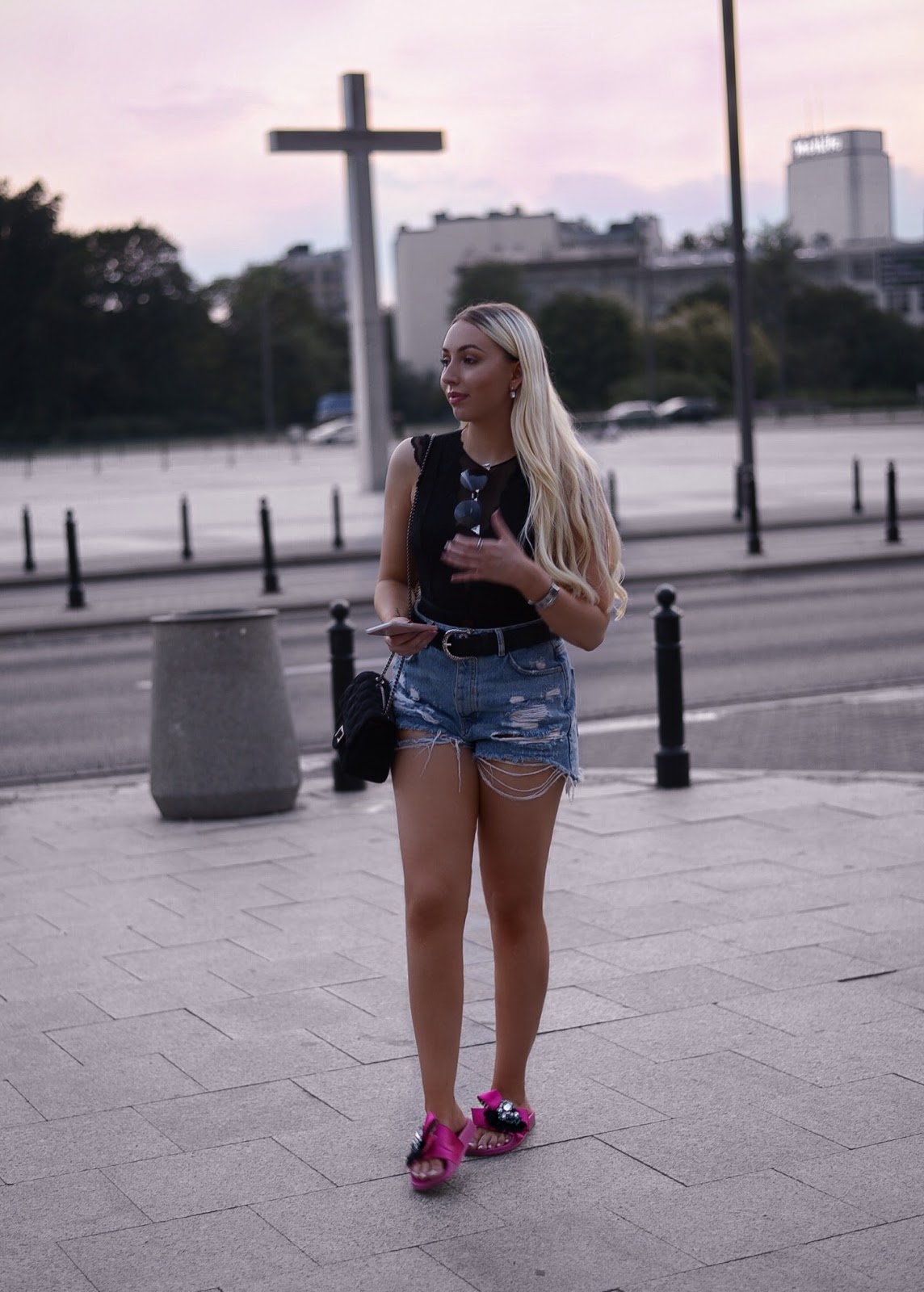 warsaw travel quide_ripped high waisted shorts_pink slides_lace bodysuit