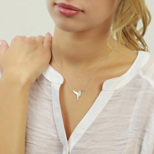 model wearing silver hummingbird necklace
