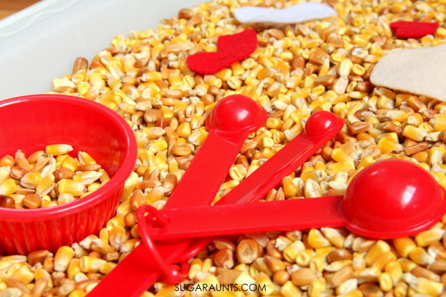 Corn sensory bin for scooping and pouring fine motor play
