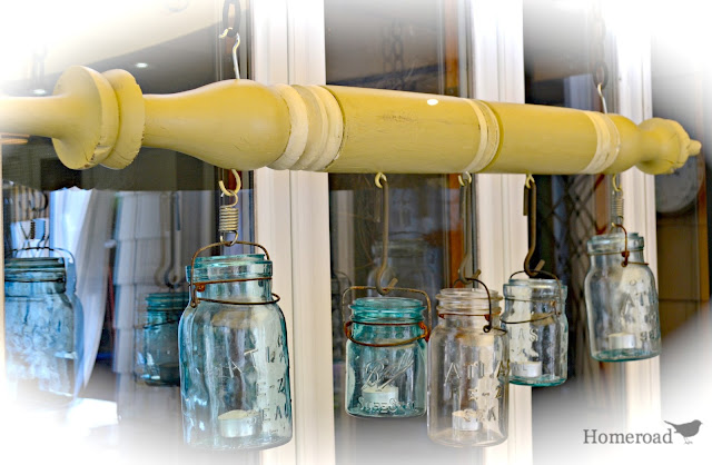 Green post with hanging blue and clear Mason Jars