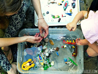 http://frogs-and-fairies.com/ocean-sensory-bin-adventure/