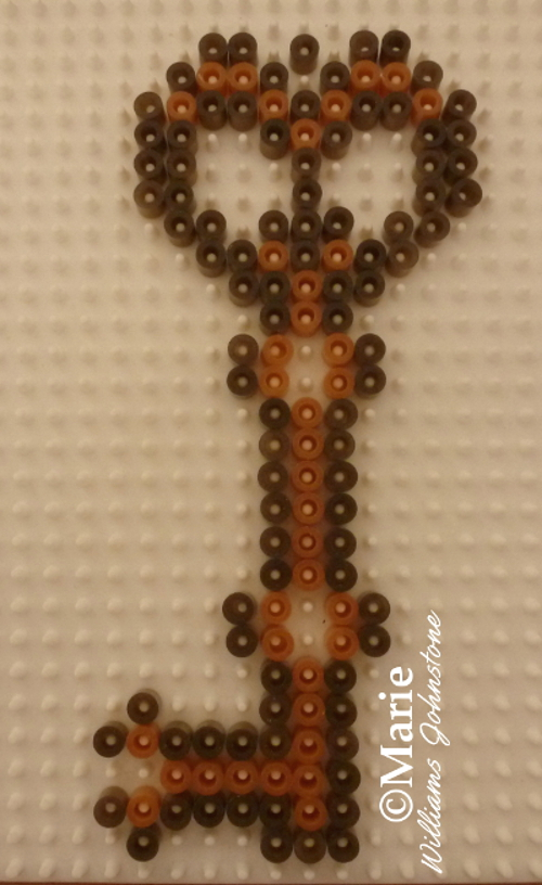 Starting to fill in the fused Perler Hama key design pattern