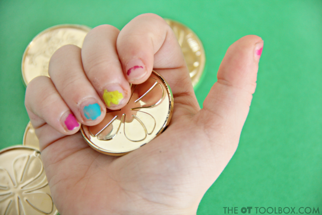 Use coins to work on fine motor skills for kids like hand strength, in-hand manipulation, translation, dexterity, precision, and more.