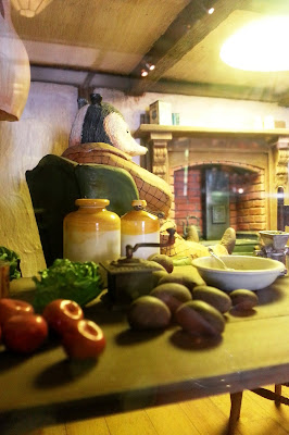 Detail of one of the one-twelfth-scale Wind in the Willows scenes at Mr Badger's cafe.