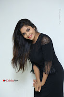 Telugu Actress Karunya Chowdary Latest Stills in Black Short Dress at Edo Prema Lokam Audio Launch .COM 0058.JPG