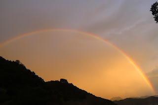rainbow with valley view