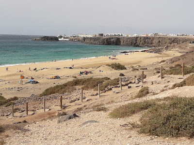 Photo of the view of El Cotillo beach and town