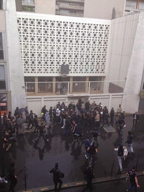 "A crowd in front of the Don Isaac Abravanel Synagogue in Paris during the ""anti-Israel"" riot of July 13, 2014."