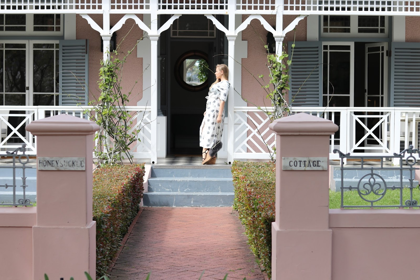 Katie Heath wearing a Warehouse bird printed dress at the Belmond Mount Nelson