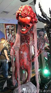 Huge red skeleton bride sculpture in the art gallery