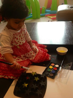Ria loved to do this then (although now she doesn't like paints on her hands)